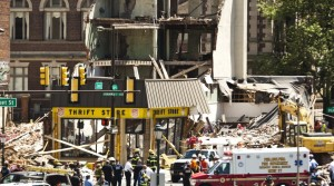 Rescue workers search through rubble following a building collapse in Philadelphia Wednesday. (REUTERS/Eduardo Munoz)