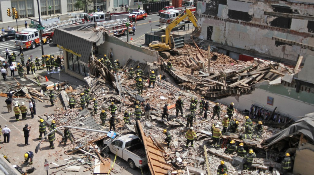 Rescue personnel search the scene of a building collapse in downtown Philadelphia Wednesday. (AP Photo/Philadelphia Inquirer, Michael Bryant)