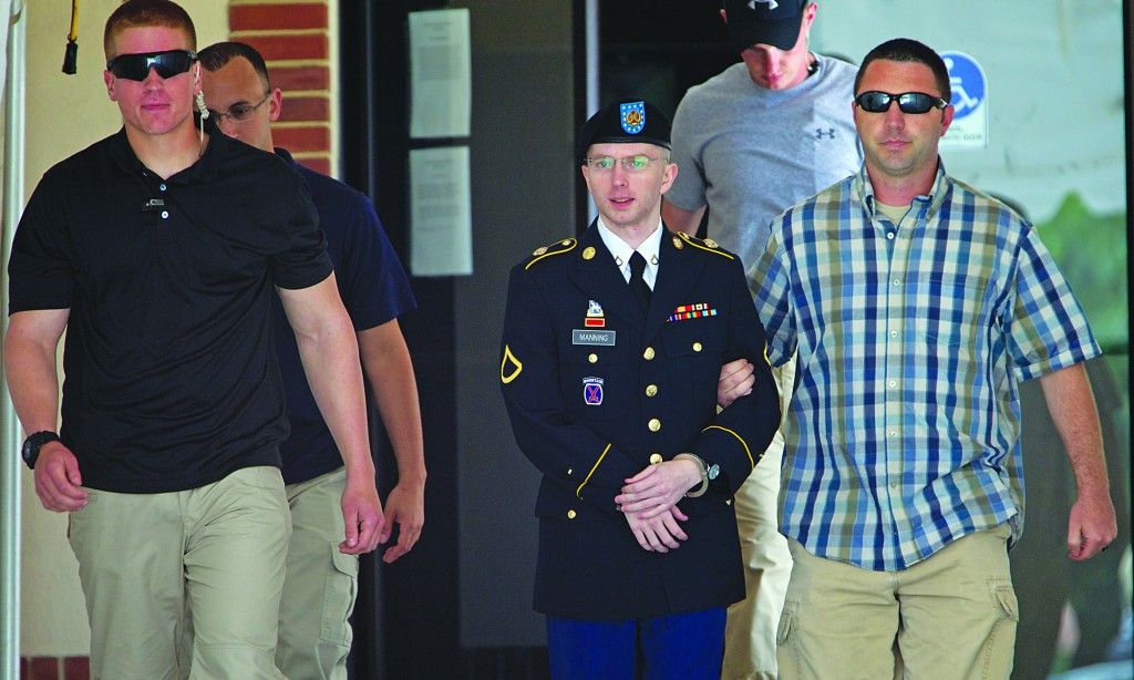 Pfc. Bradley Manning, center, is escorted out of a courthouse in Fort Meade, Md. (AP Photo/Jose Luis MaganaArmy)