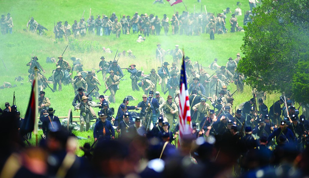 Actors playing Federal and Confederate troops reenact Pickett's Charge at the finale of the Blue Gray Alliance during events marking the 150th anniversary of the Battle of Gettysburg, in Gettysburg, Pennsylvania, Sunday. It was the battle with the highest number of casualties in the Civil War. (REUTERS/Mark Makela )
