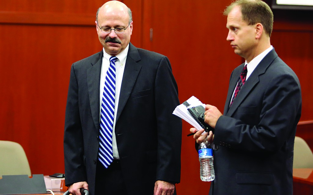Assistant state attorneys Bernie de la Rionda and Richard Matei leave the courtroom after addressing a series of pre-trail issues with Judge Debra Nelson during George Zimmerman's trial in Seminole circuit court in Sanford, Fla., Friday. (Gary W. Green/Orlando Sentinel/Pool)