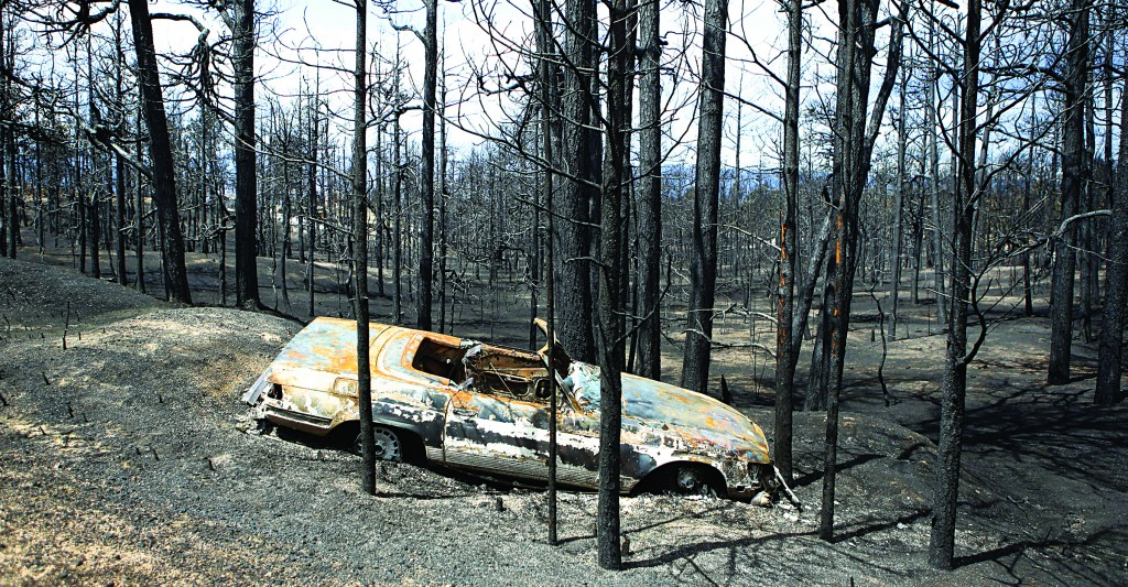 A burned automobile sits off the roadside in the burned forest on the Black Forest wildfire north of Colorado Springs, Colo., on Monday. (AP Photo/Ed Andrieski)