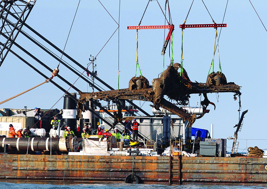 Lifting equipment raises a World War II Dornier bomber, the only surviving German Second World War Dornier Do–17 bomber, from the English Channel off Deal, southern England, Monday. (AP Photo/PA, Gareth Fuller)