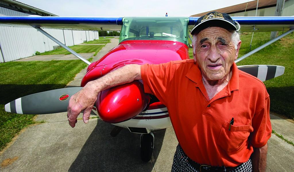 John Lawton poses by his Cessna 172 airplane in Wadsworth, Ohio, Thursday. (AP Photo/Tony Dejak)