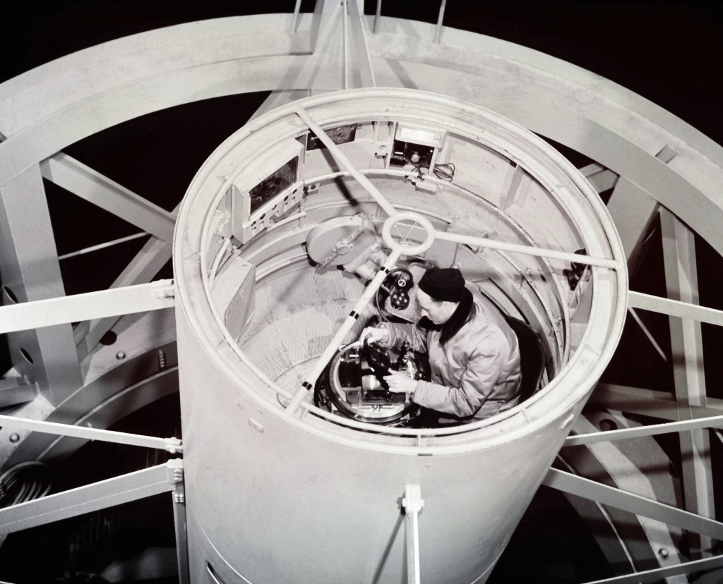 Astronomer William Baum installs a photographic plate at the prime focus of the 200-inch Hale telescope on Palomar Mountain at Palomar Observatory in California in August 1956. He works in the observers' cage. (AP Photo)