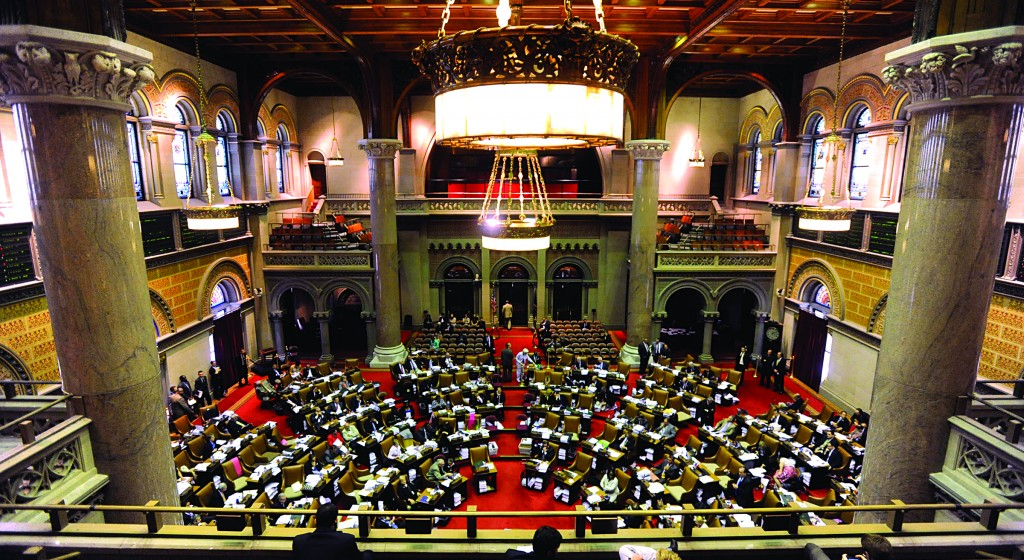 Members of the New York Assembly meet at the Capitol in Albany Friday for the final day of the legislative session. (AP Photo/Tim Roske)