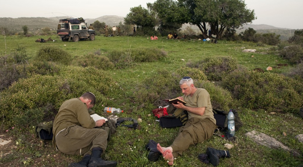 IDF reserve soldiers take a break during training in northern Israel. (Matanya Tausig/Flash90)