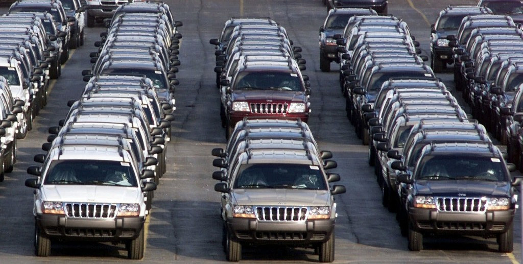 Rows of 2001 Jeep Grand Cherokees are lined up outside the Jefferson North Assembly Plant in Detroit. Chrysler is refusing a request by U.S. safety regulators to recall about 2.7 million vehicles to fix fuel tanks that could leak and cause fires in rear-end collisions. (AP Photo/Carlos Osorio, File)