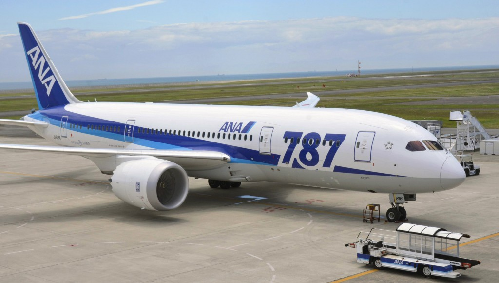 An All Nippon Airways Boeing 787, scheduled to go to Tokyo's Haneda airport, is stranded on the tarmac since its right-side engine would not start at Yamaguchi-Ube Airport in Ube, Yamaguchi Prefecture, western Japan. The Dreamliner had the trouble Wednesday, a day after a rival airline had a problem on another 787 plane. (AP Photo/Kyodo News)