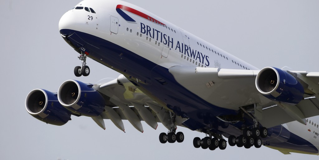 A British Airways Airbus A380 aircraft performs its demonstration flight during the first day of the 50th Paris Air Show at Le Bourget airport, north of Paris, Monday. (AP Photo/Francois Mori)