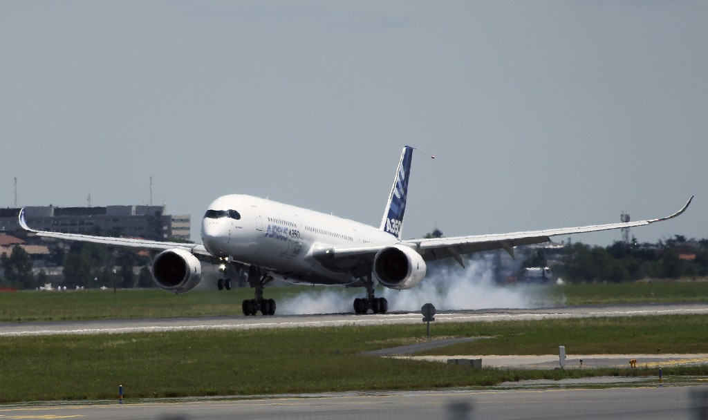 The Airbus A350 lands at Blagnac airport near Toulouse, southwestern France, after its maiden flight Friday. (AP Photo/Bob Edme)