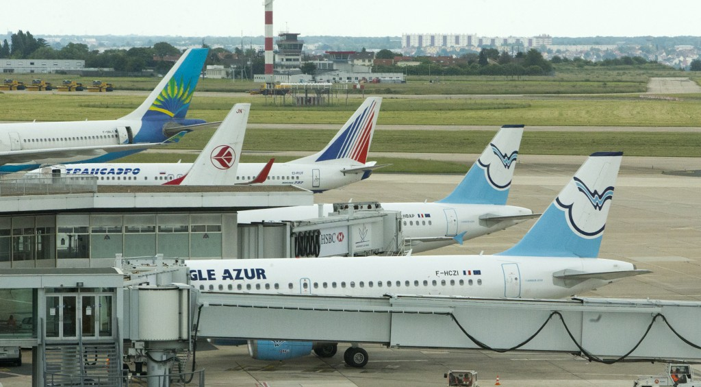 Planes stand idle on the tarmac of Orly Airport, west of Paris, France on Tuesday, during an air traffic controllers strike. (AP Photo/Jacques Brinon)