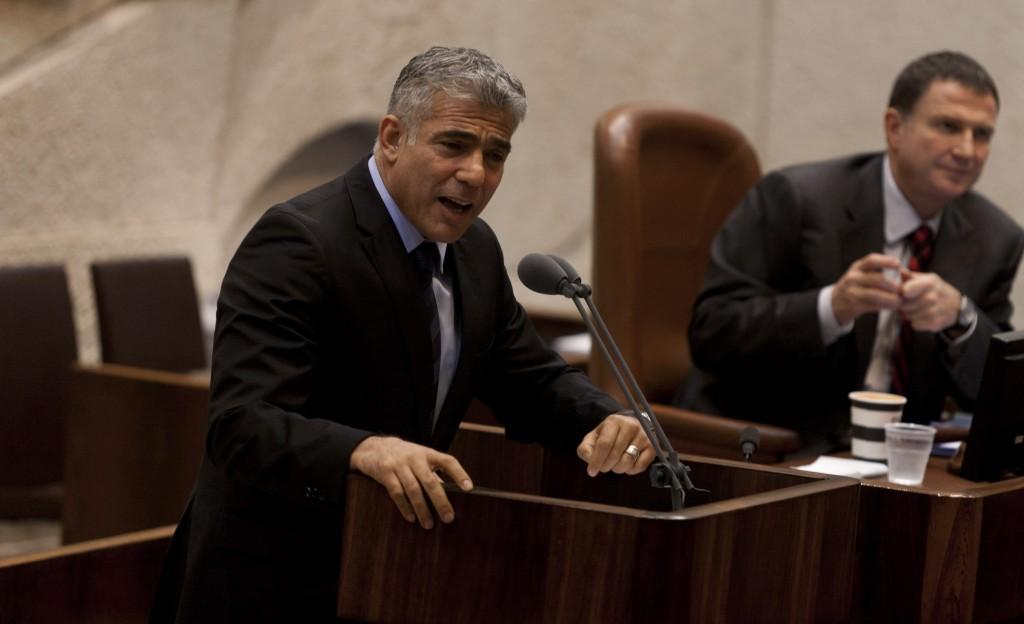 Israeli Finance Minister Yair Lapid addressing the Knesset on Monday. (Flash90)