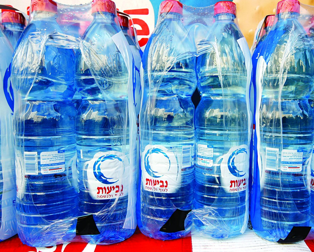 Neviot, Israel's largest mineral water producer, like other bottled water companies, enjoys cheap water rates and pays no royalties to the state.(Miriam Alster/Flash90)