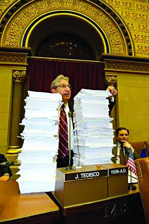 Assemblyman James Tedisco (R-Schenectady) shows stack of bills on his desk. (Office of Assemblyman James Tedisco)