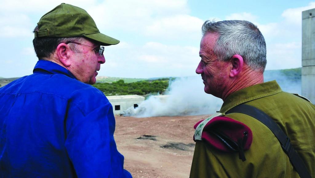 Israeli Defense Minister Boogie Yaalon (L) with IDF Chief of Staff Benny Gantz. (Ariel Hermoni/Ministry of Defense/Flash 90)