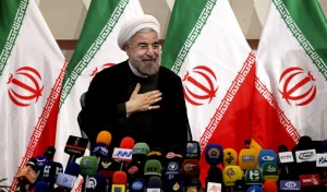 Iranian newly elected President Hasan Rowhani, places his hand on his heart as a sign of respect, after speaking at a press conference, in Tehran, Iran, Monday. (AP Photo/Ebrahim Noroozi)