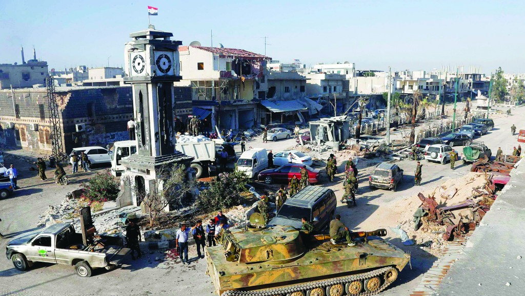 A view of soldiers loyal to the Syrian regime with tanks in Qusair, after the Syrian army took control of the city from rebel fighters, Wednesday. (REUTERS/Mohamed Azakir)