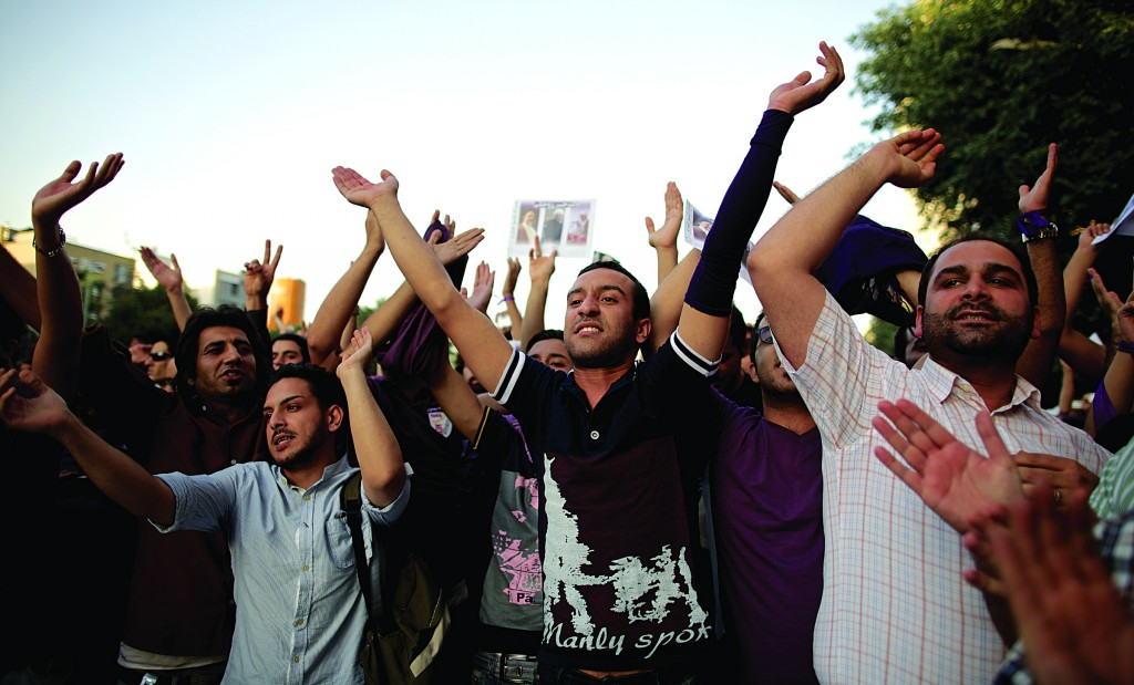 Iranian supporters of presidential candidate Hassan Rowhani celebrate his victory in downtown Tehran. (BEHROUZ MEHRI/AFP/Getty Images)