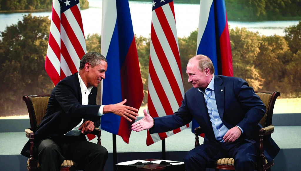 U.S. President Barack Obama and Russian President Vladimir Putin shake hands during their meeting at the G8 Summit at Lough Erne in Enniskillen, Northern Ireland, Monday. (REUTERS/Kevin Lamarque)