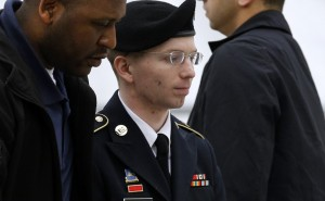 Army Pfc. Bradley Manning (C) is escorted into a courthouse in Fort Meade, Md., Tuesday, May 21, before a pretrial military hearing. (AP Photo/Patrick Semansky)