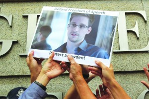 Protesters in support of Edward Snowden, a contractor at the National Security Agency (NSA), hold a photo of him during a demonstration outside the U.S. Consulate in Hong Kong. (REUTERS/Bobby Yip)