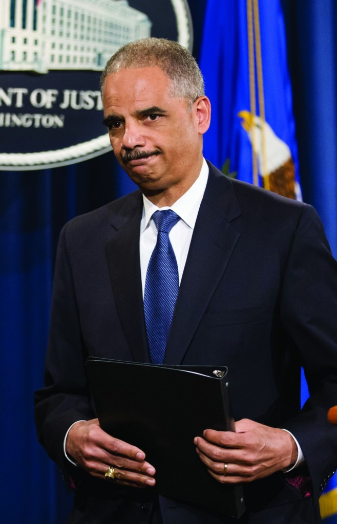 Attorney General Eric Holder leaves after speaking where he expressed disappointment in the Supreme Court's 5-4 ruling in the Alabama voting rights case, Shelby County v. Holder, Tuesday, at the Justice Department in Washington. (AP Photo/J. Scott Applewhite)
