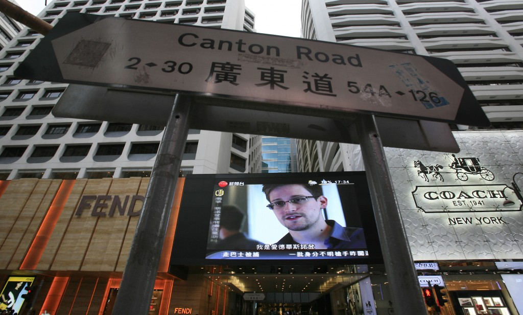 A screen at a shopping mall in Hong Kong shows a news report of Edward Snowden, a former CIA employee who leaked top-secret documents about sweeping U.S. surveillance programs. (AP Photo/Vincent Yu)