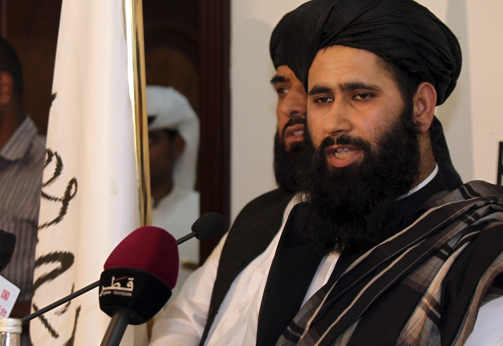Muhammad Naeem, a representative of the Taliban, speaks during a press conference at the official opening of their office in Doha, Qatar, Tuesday.(AP Photo/Osama Faisal