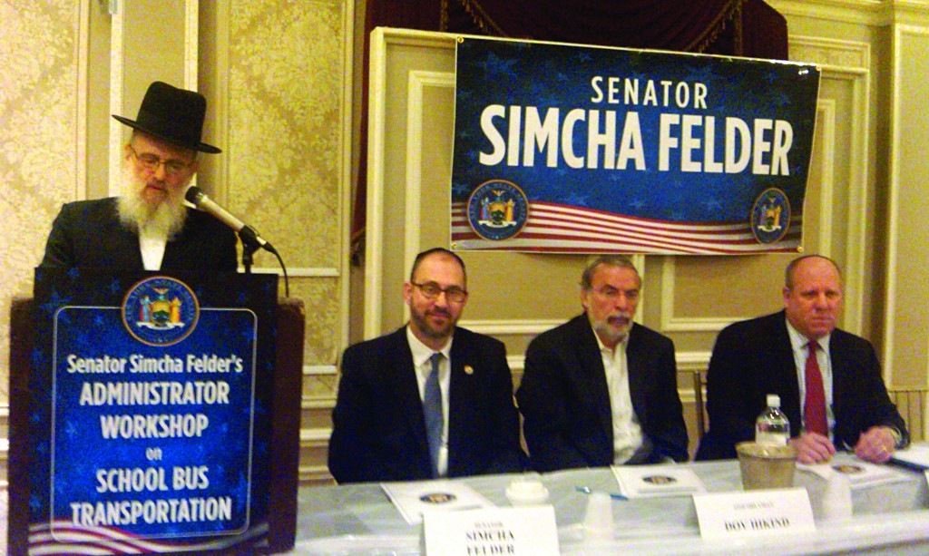 Rabbi Aharon Welz, who hosted the event, introducing the program Wednesday, as (L-R) state Sen. Simcha Felder, Assemblyman Dov Hikind and Eric Goldstein of the city's education department listen.