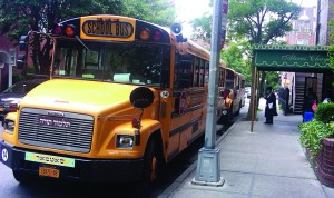 Buses are lined up outside Ateres Chaya hall Wednesday morning, following the event in which yeshivah administrators were briefed on how to deal with the new busing law.