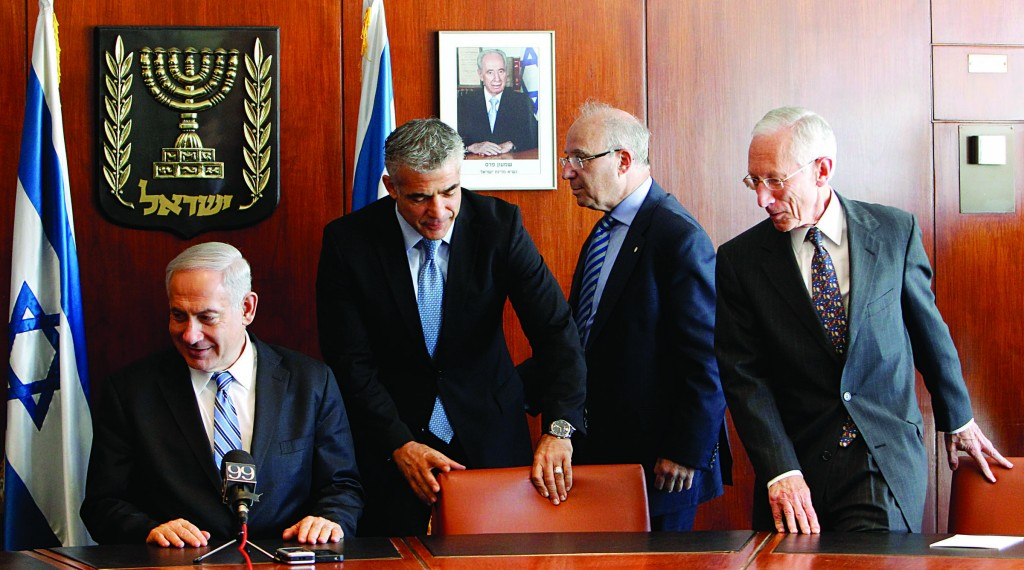 Changing of the guard. L-R: Israel's Prime Minister Binyamin Netanyahu, Finance Minister Yair Lapid, Incoming Bank of Israel Governor Jacob Frenkel and outgoing Bank of Israel Governor Stanley Fischer, at a press conference in the Knesset on Monday.(Miriam Alster / Flash90)