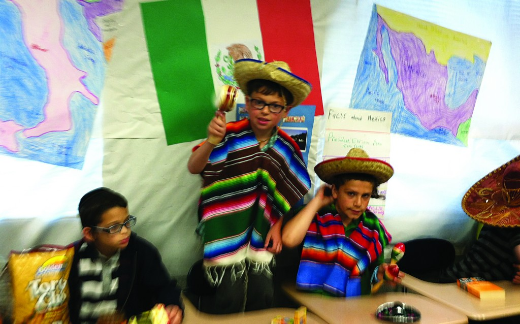Fourth-graders at The Cheder in Boro Park produce displays representing eight countries around the world as part of their geography curriculum.