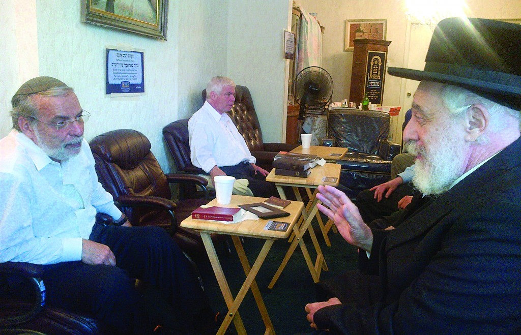 The Liske Rebbe at a nichum aveilim Friday at Assemblyman Dov Hikind's home, where he has been sitting shivah for his mother.