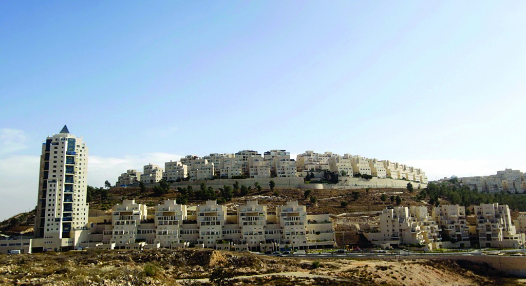 A general view of Har Homa in east Yerushalayim, where Israel authorized construction of 69 housing units this week, ahead of U.S. Secretary of State John Kerry's visit to the region. (REUTERS/Ammar Awad)