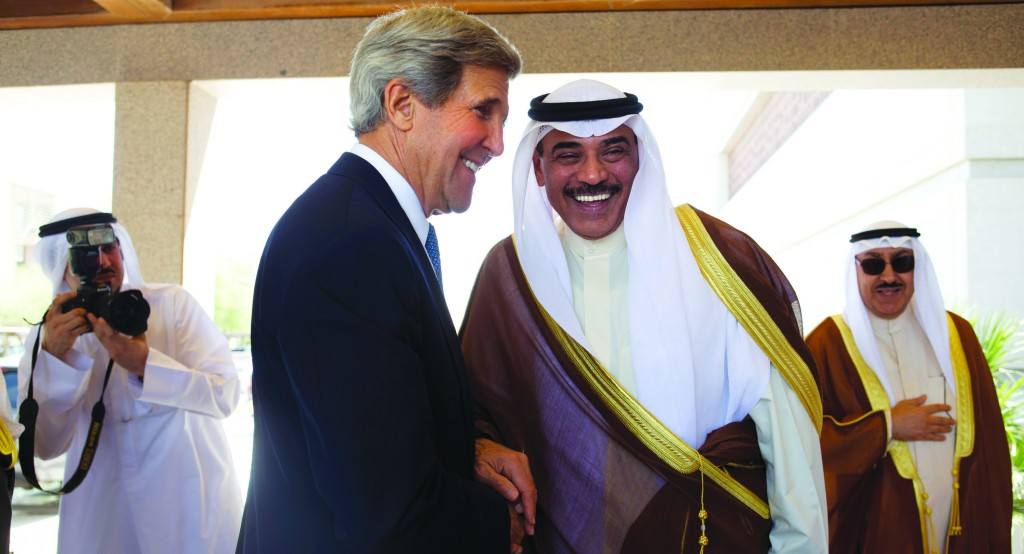 Secretary of State John Kerry is greeted by Kuwaiti Foreign Minister Sheikh Sabah Khalid Al-Hamad Al-Sabah, before their meeting at Bayan Palace in Kuwait City on Wednesday. (AP Photo/Jacquelyn Martin, Pool)