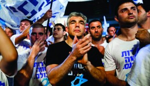 """Left-winger Uri Avnery: """"I am angered by the behavior of Yair Lapid [pictured above] and Naftali Bennett who have seized the subject of drafting chareidim as if it were the most important thing the country faces — when they both understand that nothing will come of this."""" (Tali Mayer/Flash90)"""