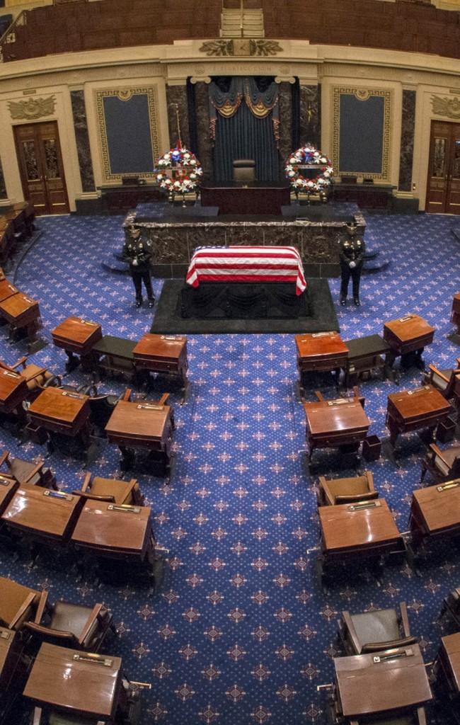 The flag-draped casket of Sen. Frank Lautenberg rests in the Senate chamber Thursday. (AP Photo/Bill O'Leary)