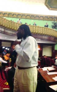 Councilman Jumaane Williams jumps out of his seat as the bills gain a veto-proof majority early Thursday morning in City Hall.