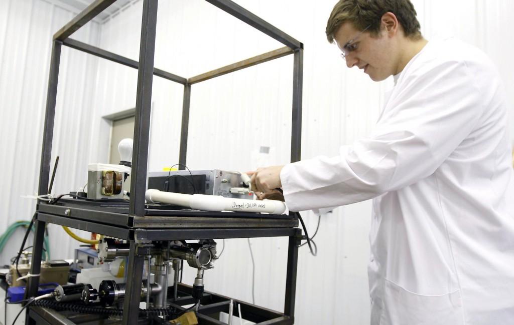 Conrad Farnsworth, 18, demonstrates the fusion reactor he hand-built in his garage in Newcastle, Wyo. (AP Photo/The Casper Star-Tribune, Dan Cepeda)