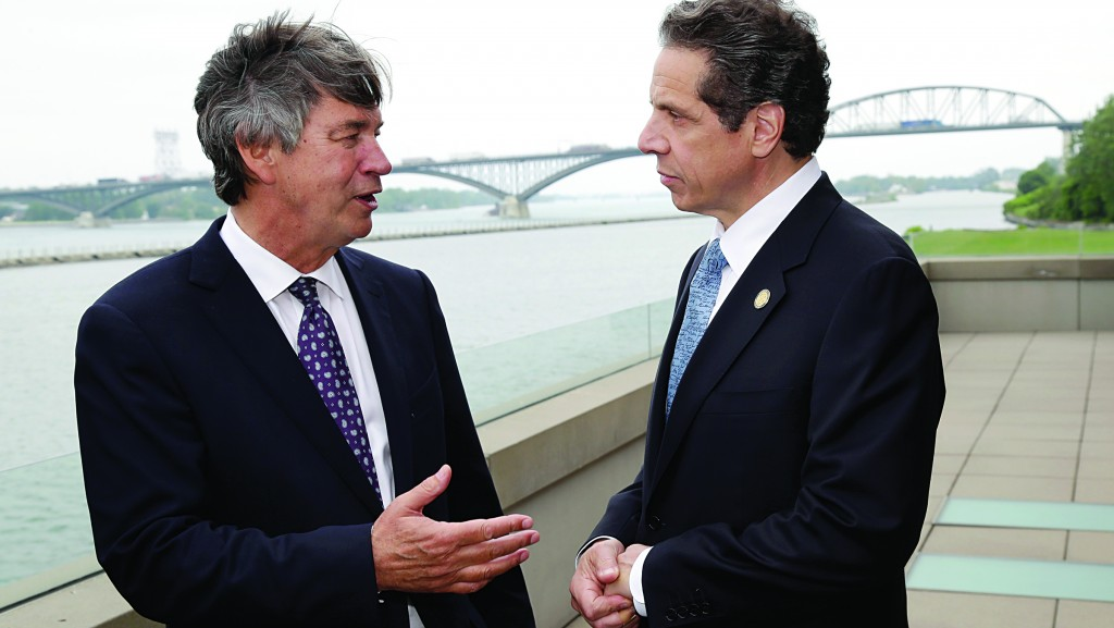 New York Gov. Andrew Cuomo (R) talks with Ambassador Gary Doer of Canada after announcing a Peace Bridge deal in Buffalo, Wednesday. (AP Photo/David Duprey)