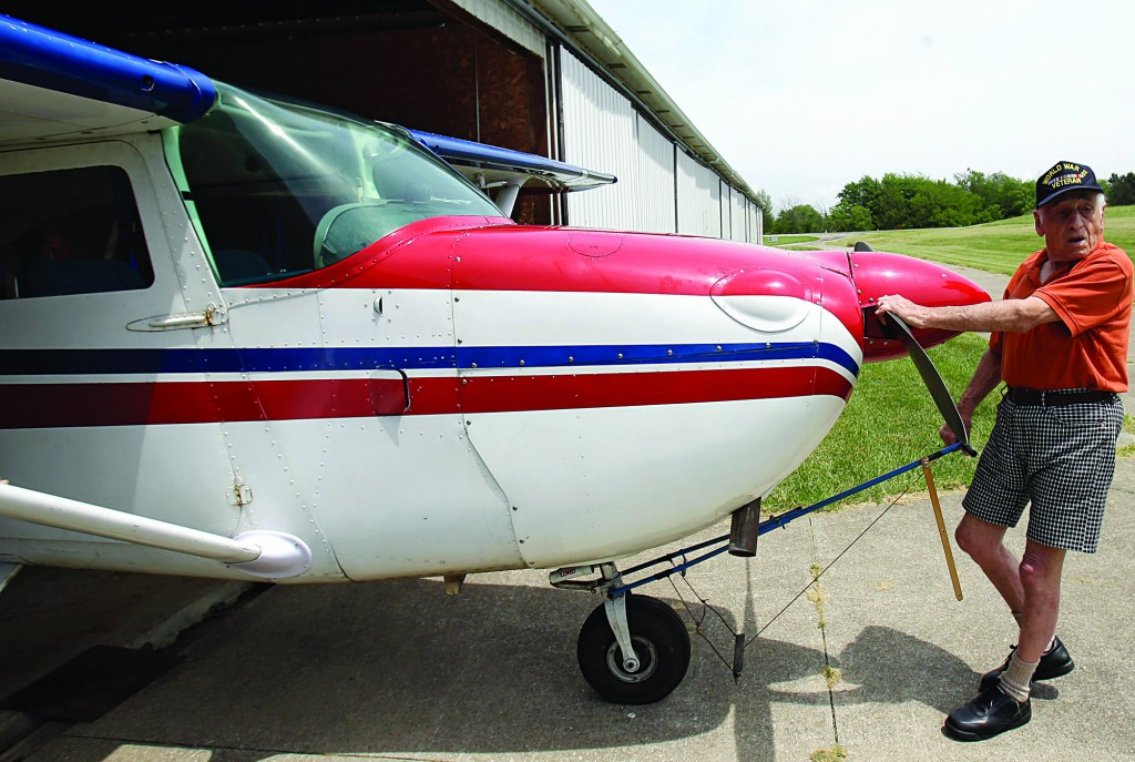John Lawton pulls his airplane out of the hangar in Wadsworth, Ohio, Thursday, as he prepares to make 90 flyovers across the U.S.-Canada border. (AP Photo/Tony Dejak)