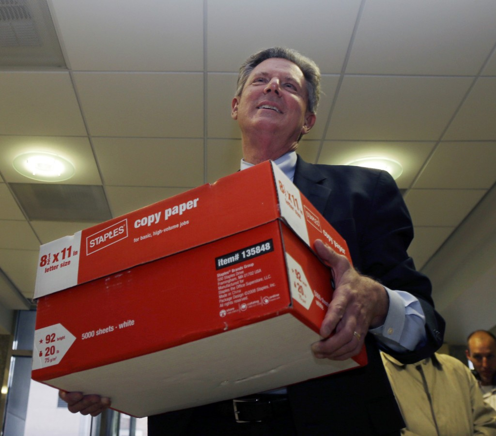Rep. Frank Pallone carries a box of petitions to run for U.S. Senate into the state division of elections in Trenton Monday. (AP Photo/Mel Evans)