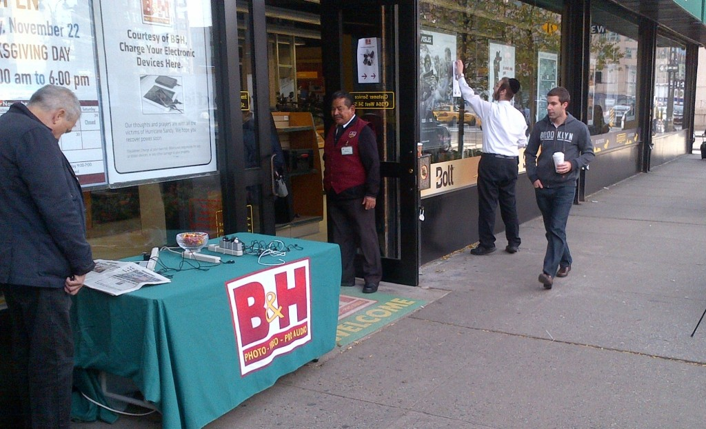 A sign in front of B&H Photo in Manhattan inviting New Yorkers to charge their phones using their generators, days after Superstorm Sandy hit the Northeast on Oct. 29, 2012.