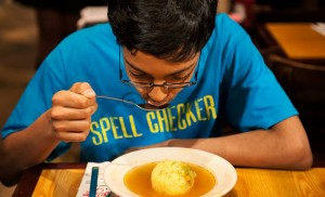 Arvind Mahankali eats his first knaidel at City Hall on Tuesday.