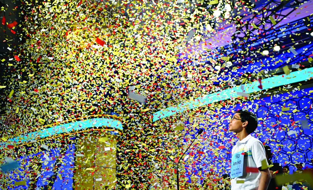 Arvind Mahankali, 13, of Queens watches confetti fall after he won the Scripps National Spelling Bee in Oxon Hill, Md., Thursday. (AP Photo/Cliff Owen)