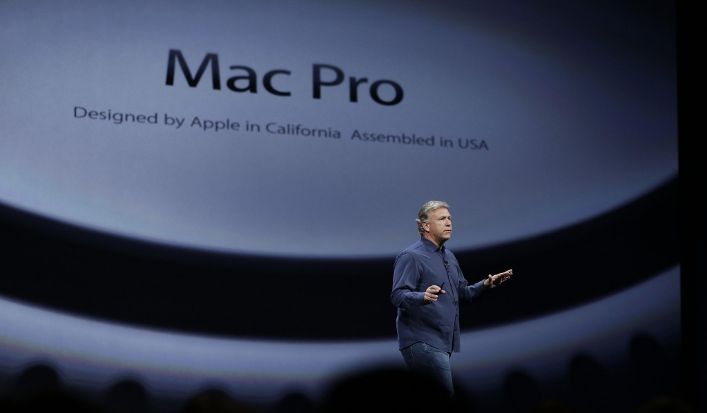 Phil Schiller, the senior vice president of worldwide marketing at Apple, talks about the new Mac Pro during the keynote address of the Apple Worldwide Developers Conference Monday, in San Francisco. (AP Photo/Eric Risberg)