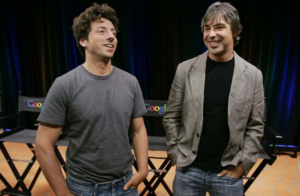 In this Sept. 2, 2008 file photo, Google co-founders Sergey Brin, left, and Larry Page talk during a news conference at Google Inc. headquarters in Mountain View, Calif. (AP Photo/Paul Sakuma, File)
