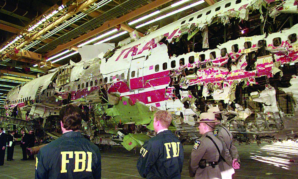 FBI agents and New York state police on Nov. 19, 1997, guard the reconstructed TWA Flight 800 in Calverton, N.Y. (AP Photo/Mark Lennihan)