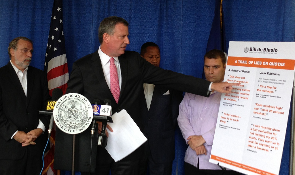Public Advocate Bill de Blasio points to a graph showing the doubling of business fines over the past two years at a press conference, Wednesday. Seen on the left is Assemblyman Dov Hikind. (Office of the Public Advocate)